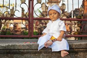 Portrait of balinese child in traditional costume - Sarong photo