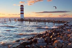Lighthouse in Lake Neusiedl at sunset photo