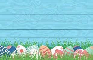 cartaz de Páscoa com ovos na grama contra madeira vetor