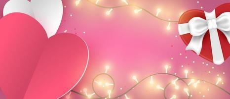 papel en forma de corazón y caja de regalo con luces brillantes