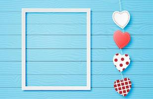 White frame with heart string on blue wood vector