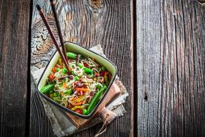 Chinese noodles and vegetables photo