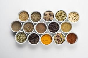 large collection of different spices and herbs isolated