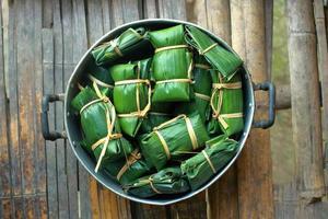 Thai dessert wrapped in banana leaves