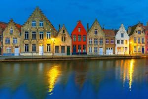 Night Bruges canal with beautiful colored houses photo
