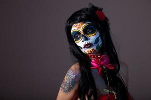 Sugar skull girl with red rose photo