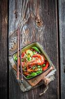 Tasty noodles with fresh vegetables and shrimps photo