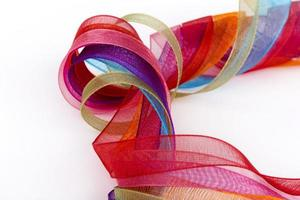 colored satin ribbons isolated on a roll