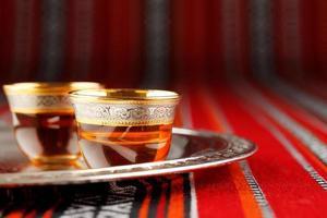 Tray of Arabian tea cups on Arabian woven fabric