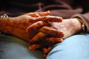 Bride's folding hands II photo