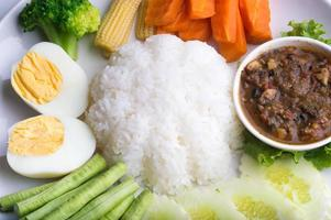 Chilli paste with rice and vegetable photo