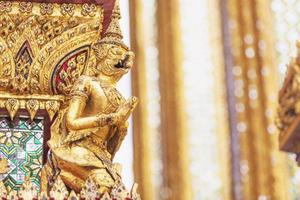 The golden garuda statues side view photo