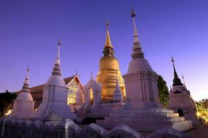 Golden stupa in dusk at acient temple, Northern thailand