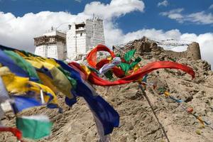 Namgyal Tsemo Gompa with prayer flags photo