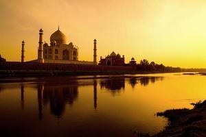 Taj Mahal at sunset refected in the Yamuna river.