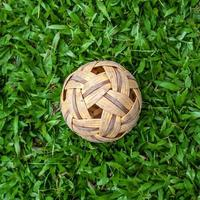Rattan ball on green grass background