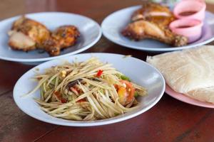 Spicy green papaya salad and grilled chicken