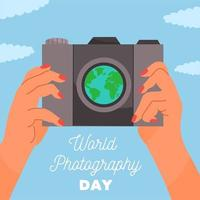 World photography day design with hands holding camera vector