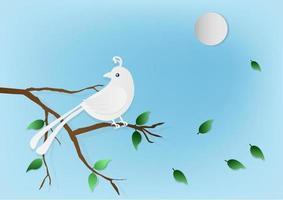 Bird on branch against blue sky