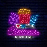 Bright neon cinema sign with popcorn
