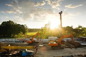 modern orange excavator machines photo