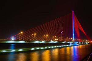 Night view of bridge Danang Vietnam photo