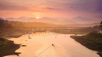 Mon wood Bridge and sunrise photo