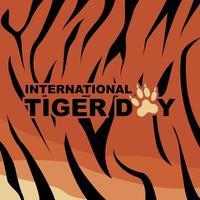typographie de la journée internationale du tigre sur motif de rayures de tigre