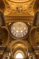 The golden dome and interior inside the church in Budapest photo
