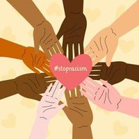 Stop racism concept with multiracial hands holding heart
