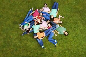 People laying in dogpile outdoors photo