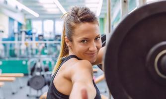 Woman with thumbs up smiling and resting after training