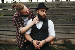 barber shaves a bearded man photo