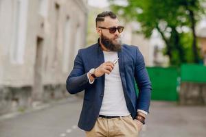 bearded man with e-cigarette photo