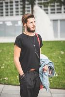 young handsome bearded hipster man photo