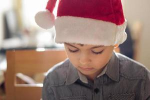 Boy with santa hat photo