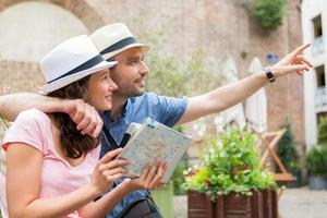 Young couple of tourists visiting city