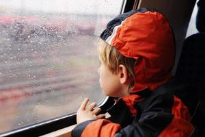 Seven years old boy sitting in the train photo