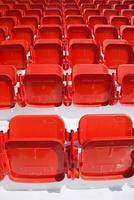empty, red stadium seats photo