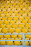 empty, yellow stadium seats photo