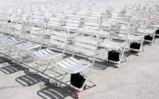 Rows of empty metal chair seats