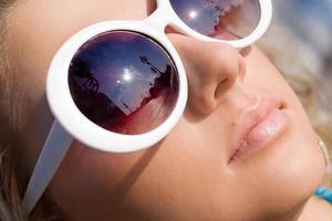Beautiful girl in sun glasses photo