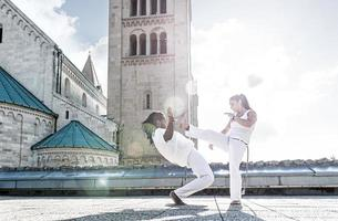 Pair of capoeira performers doing a kicking photo