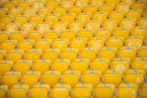 empty, yellow stadium seats