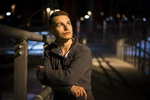 Handsome blond young man alone in urban setting