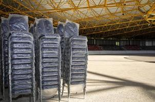 New empty chairs covered in plastics at ice skating stadium