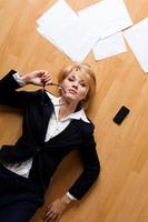 young businesswoman lying on floor
