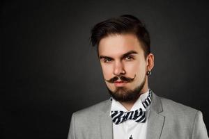 handsome guy with beard and mustache in suit photo