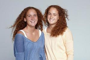 Portrait of twin sisters photo