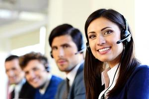 Smiling businesspeople in a call center